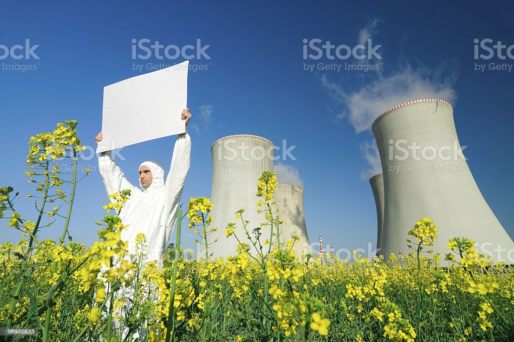 Man with sign at nuclear plant royalty-free stock photo
