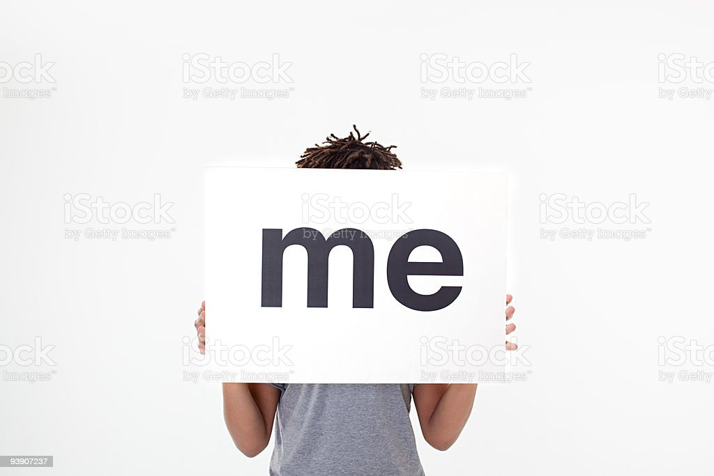 Man with sign that says me stock photo