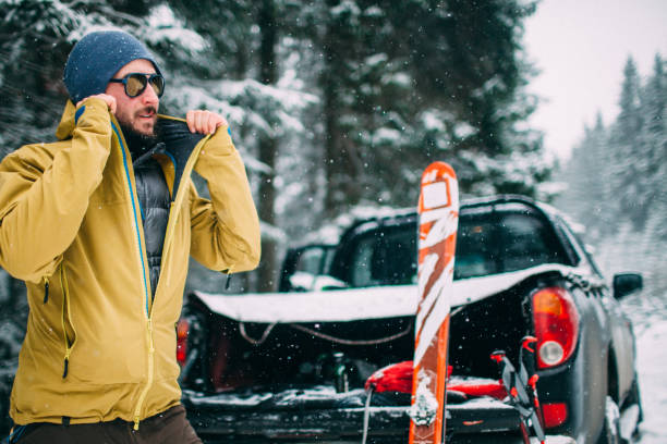 man with ski in the snow forest standing near car Young man with ski in the snow forest standing near the car ski holiday stock pictures, royalty-free photos & images