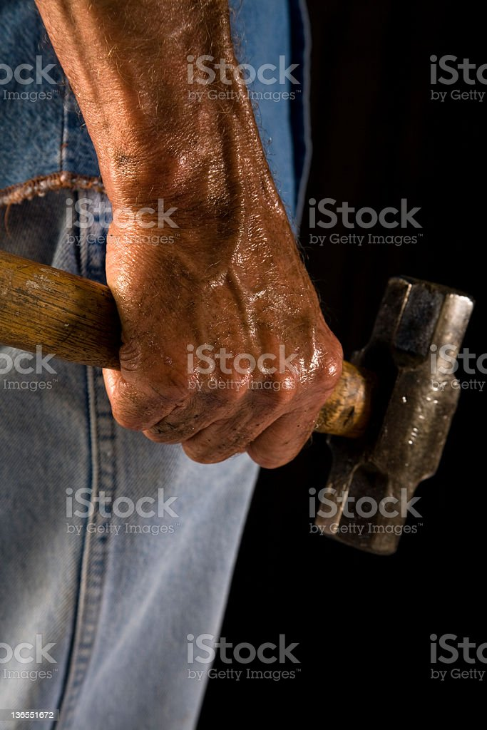 Man with sledgehammer. stock photo