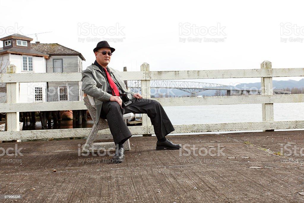 Man with SLR camera royalty free stockfoto