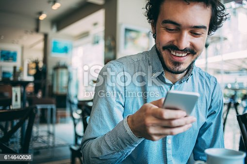istock Man with smart phone 614640636