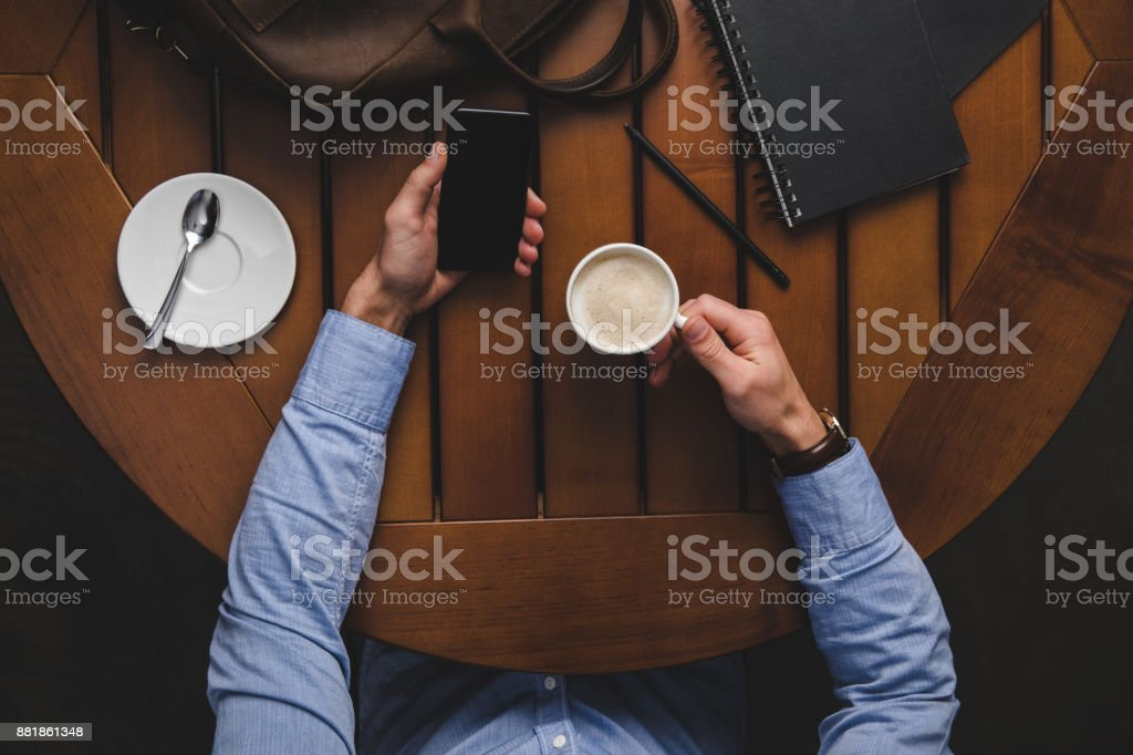 man with smartphone drinking coffee stock photo