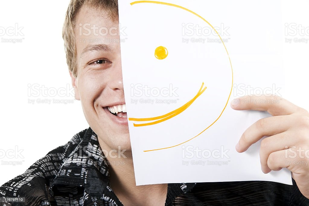 man with smiley on half of his face stock photo