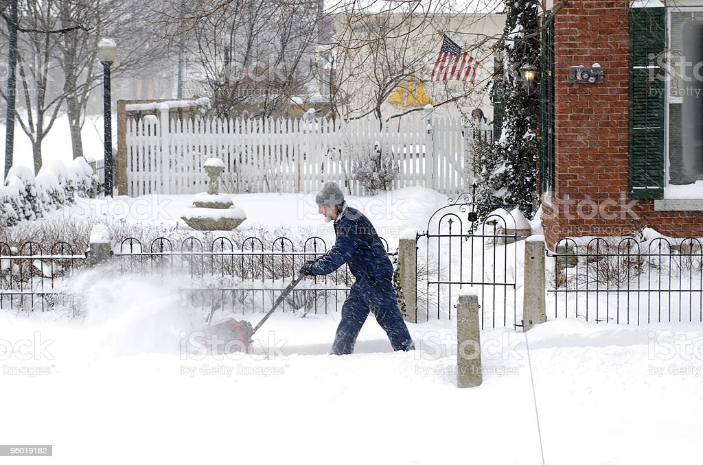 Man with Snow Blower stock photo