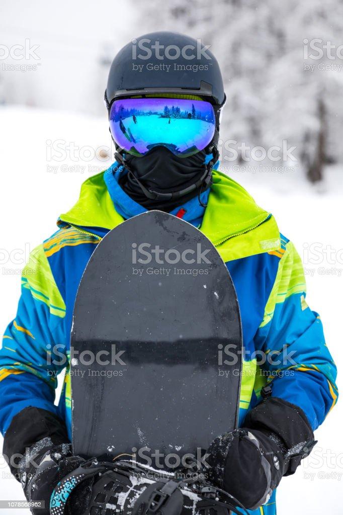 Man with snowboard portrait stock photo