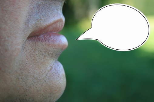 Man With Speech Balloon Stock Photo - Download Image Now