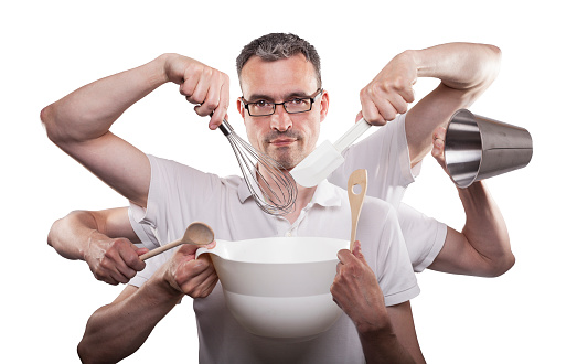 Man with multiple arms holding kitchen appliances in his hands preparing dough