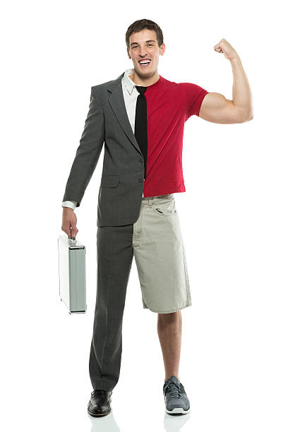 Man with split personality carying briefcase and flexing muscles stock photo