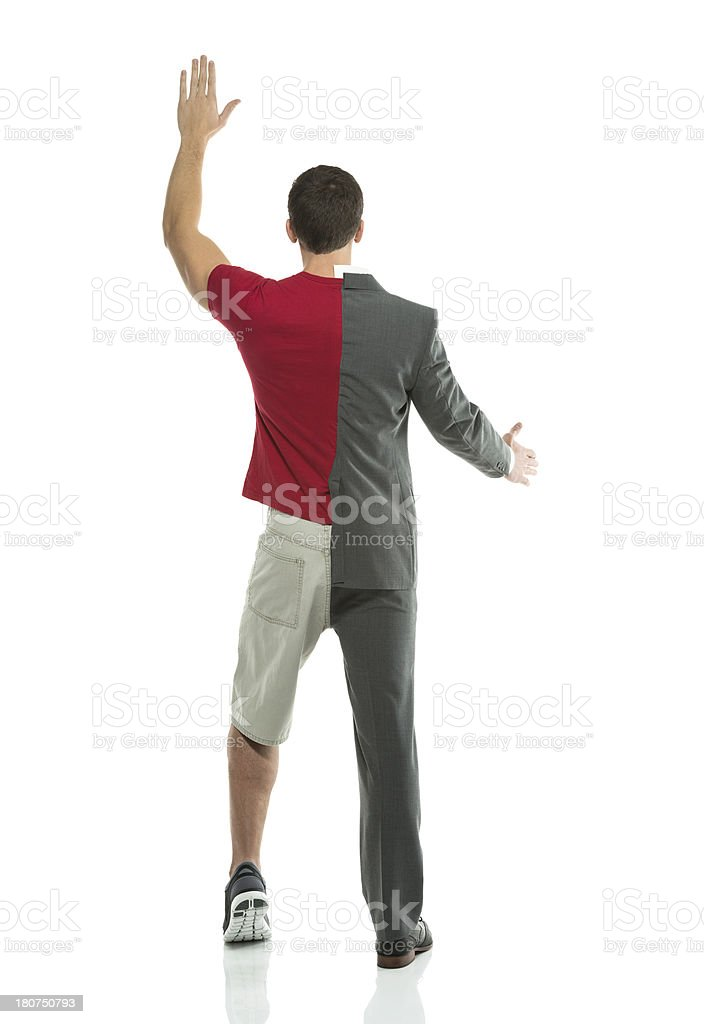 Man with split personality waving hands royalty-free stock photo