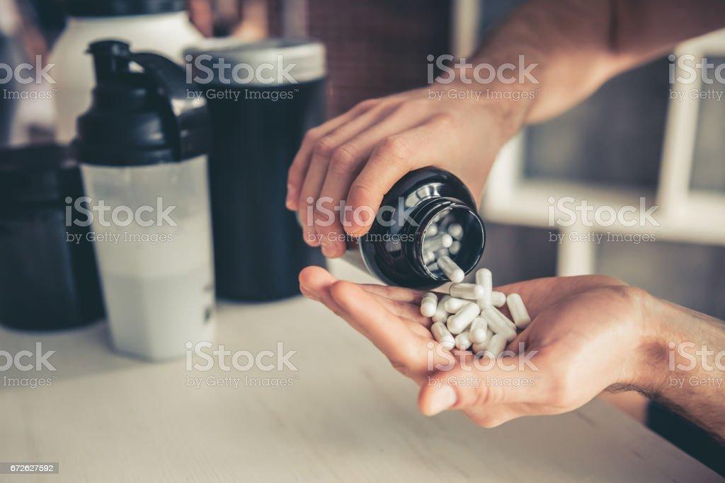 Man with sport nutrition ロイヤリティフリーストックフォト