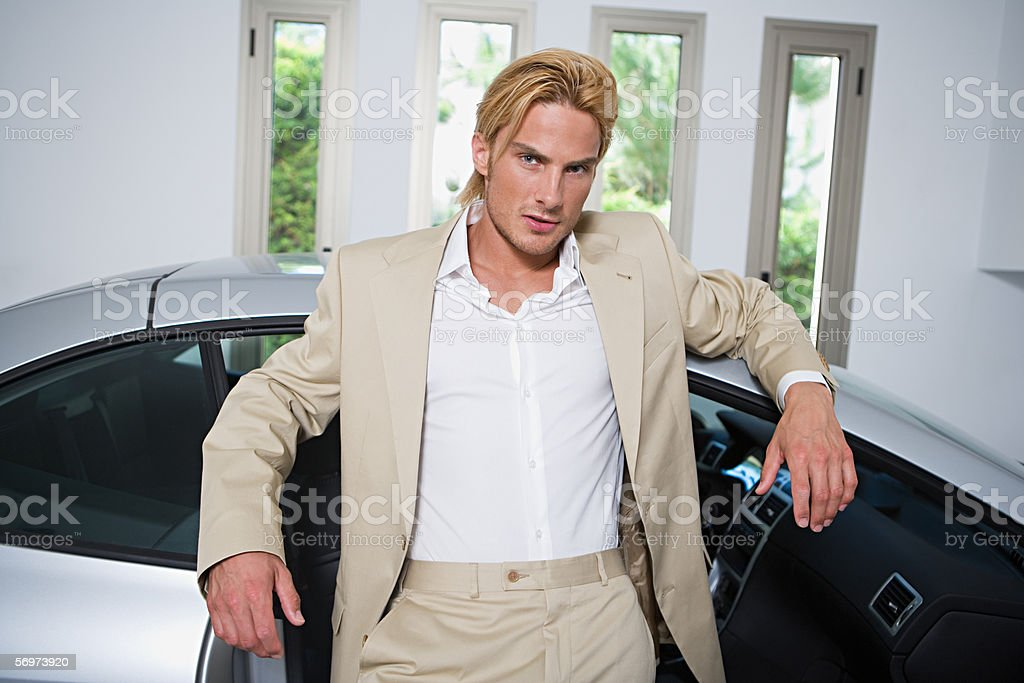 Man with sports car stock photo
