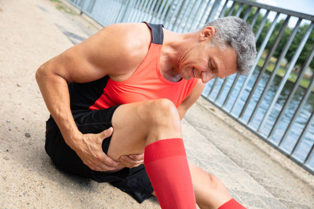 Man With Sprain Thigh Muscle Close-up Of A Mature Man With Sprain Thigh Muscle hamstring stock pictures, royalty-free photos & images
