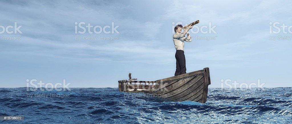 Man with spyglass stock photo