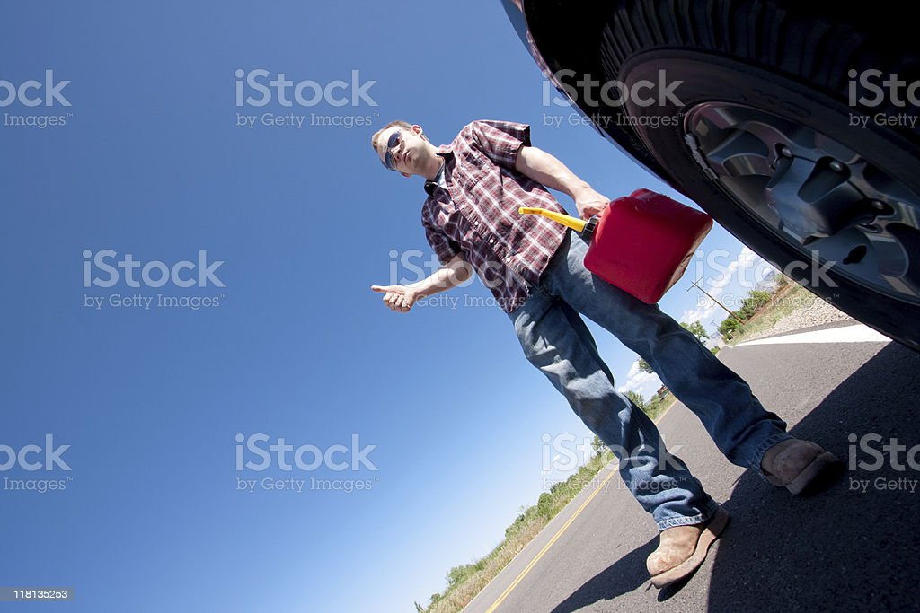 Man with Stalled Vehicle Hitchhiking stock photo