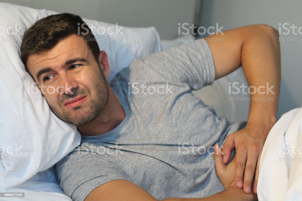 Man with stomach pain suffering stock photo
