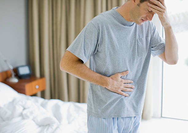Man with stomachache and headache stock photo