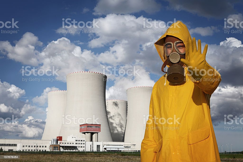 Man With 'Stop' Gesture in Front of Nuclear Reactor royalty-free stock photo