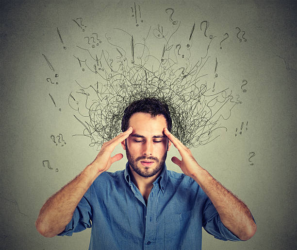 man with stressed face expression brain melting into lines stock photo
