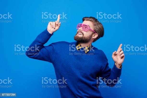 Man with sunglasses dancing at studio shot picture id877337294?b=1&k=6&m=877337294&s=612x612&h=9qvr425yzamfwmzcreaoy5svyrksdqovdqpec83pkfq=