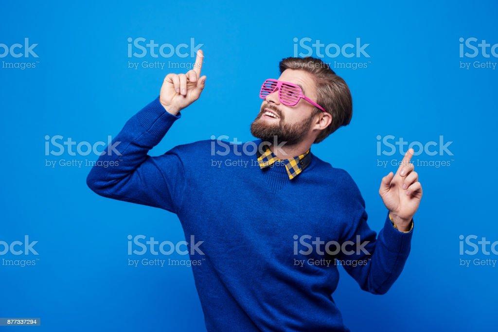 Man with sunglasses dancing at studio shot stock photo