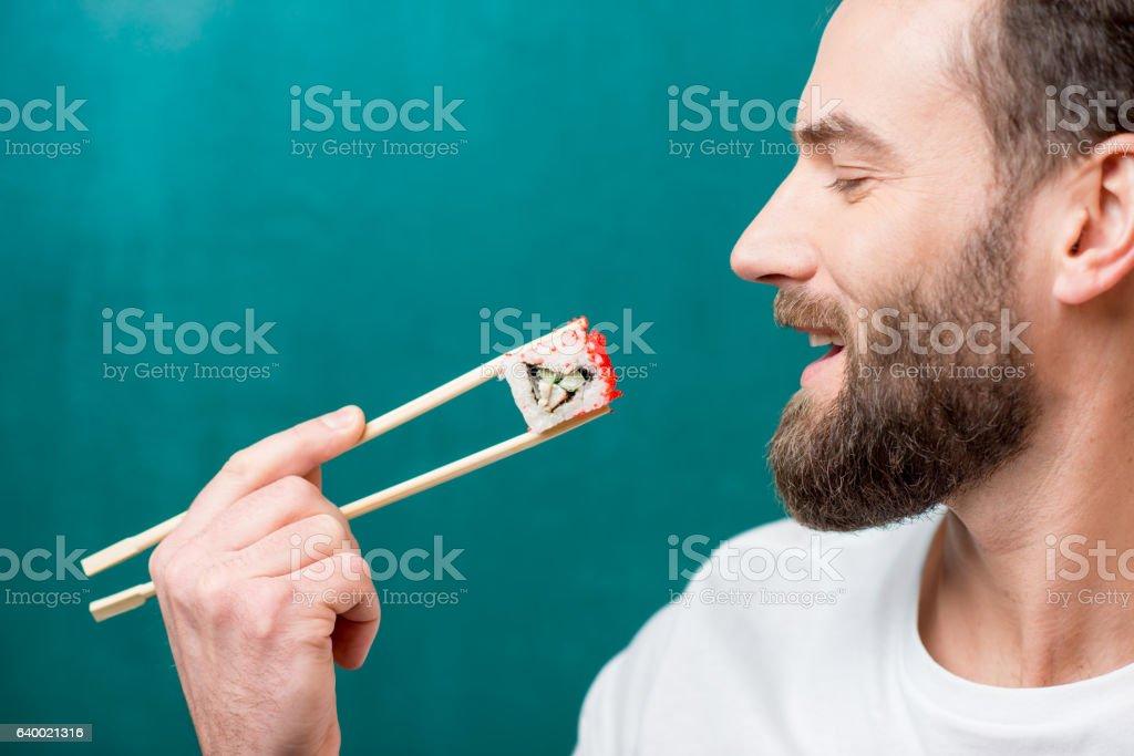 Man with sushi stock photo