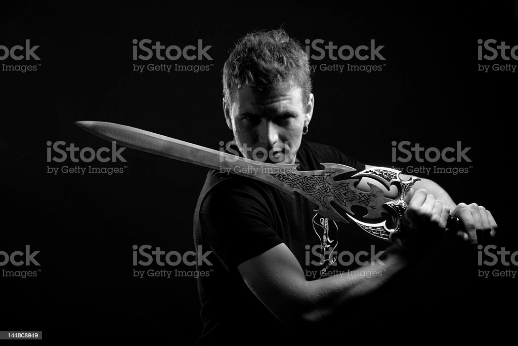 man with sward in black and white royalty-free stock photo