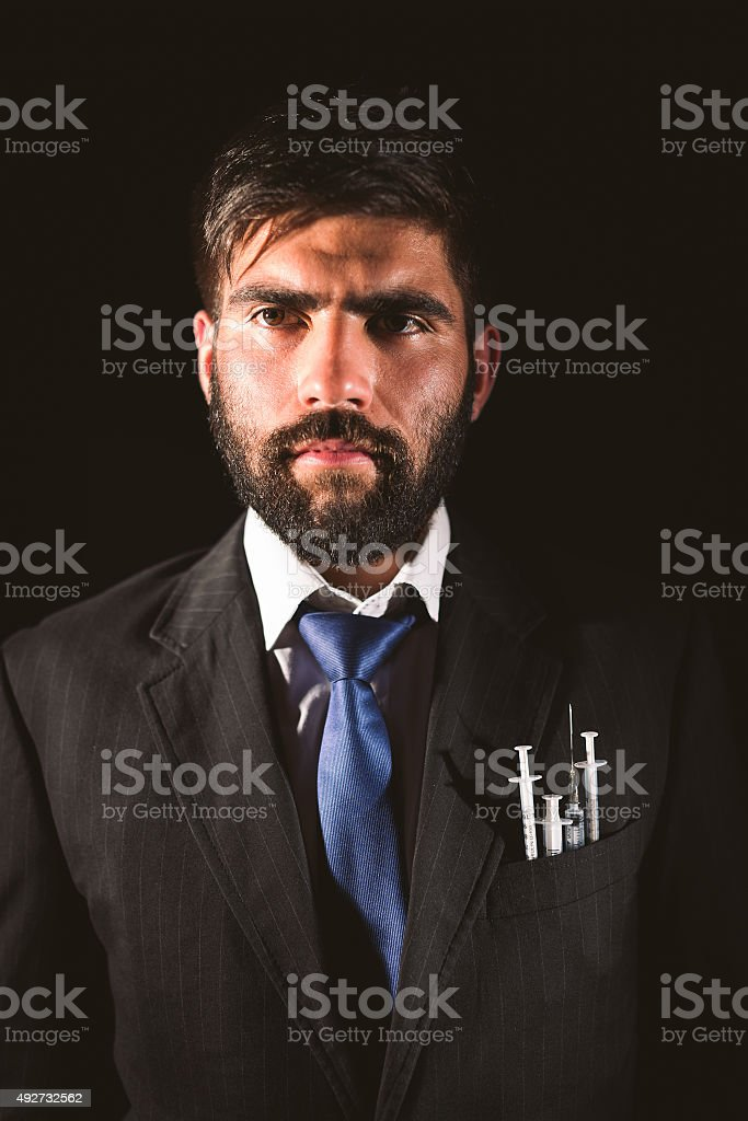 Man with syringe stock photo