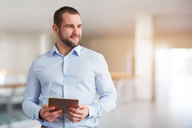 Man with tablet computer in the business center stock photo