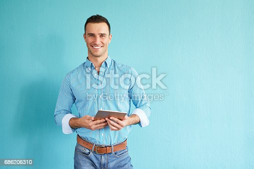 istock Man with tablet computer 686206310