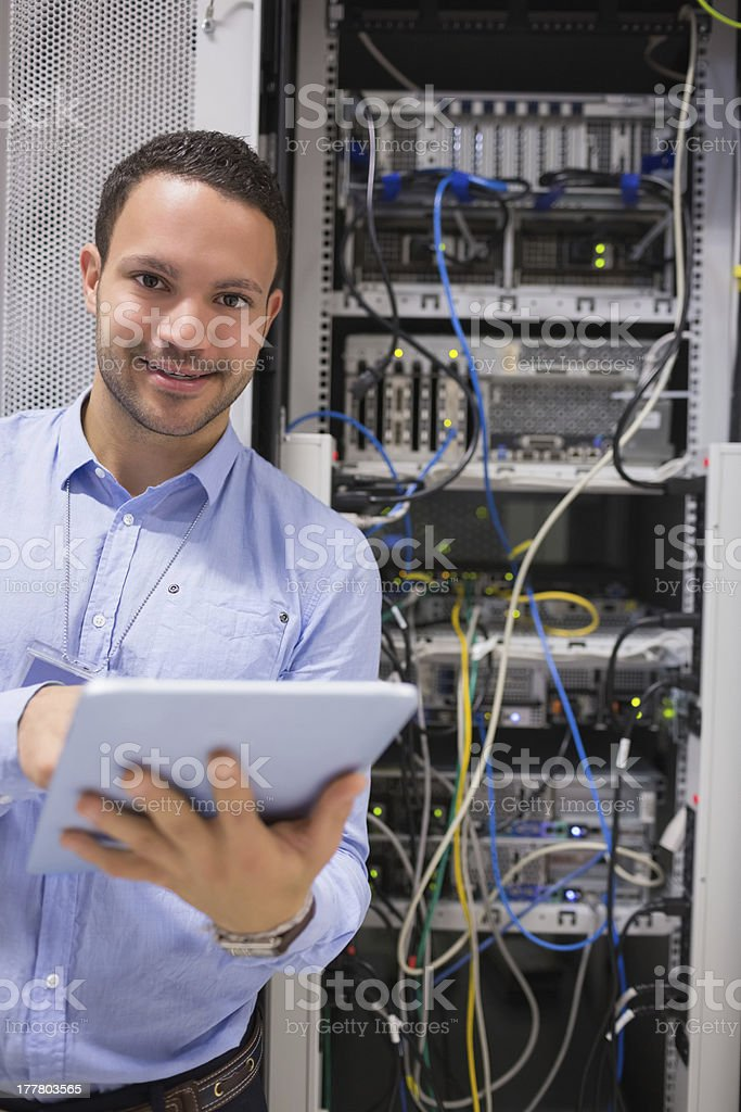 Man with tablet pc in data centre stock photo