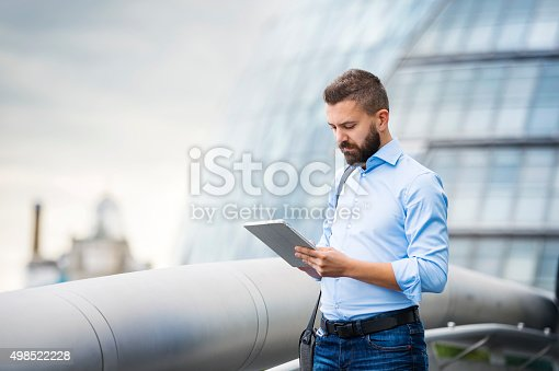istock Man with tablet 498522228