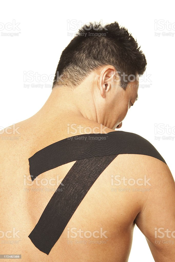 Man with Taped Shoulder Injury stock photo