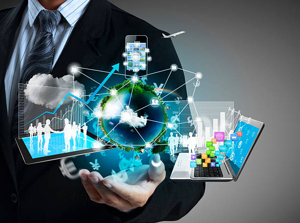 Man with technology icons floating above his hand stock photo
