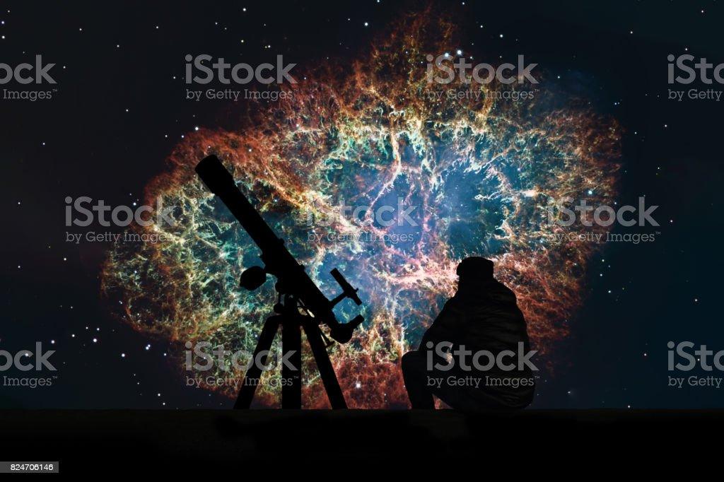 Man with telescope looking at the stars. Crab Nebula in constellation Taurus. Supernova Core pulsar neutron star. stock photo