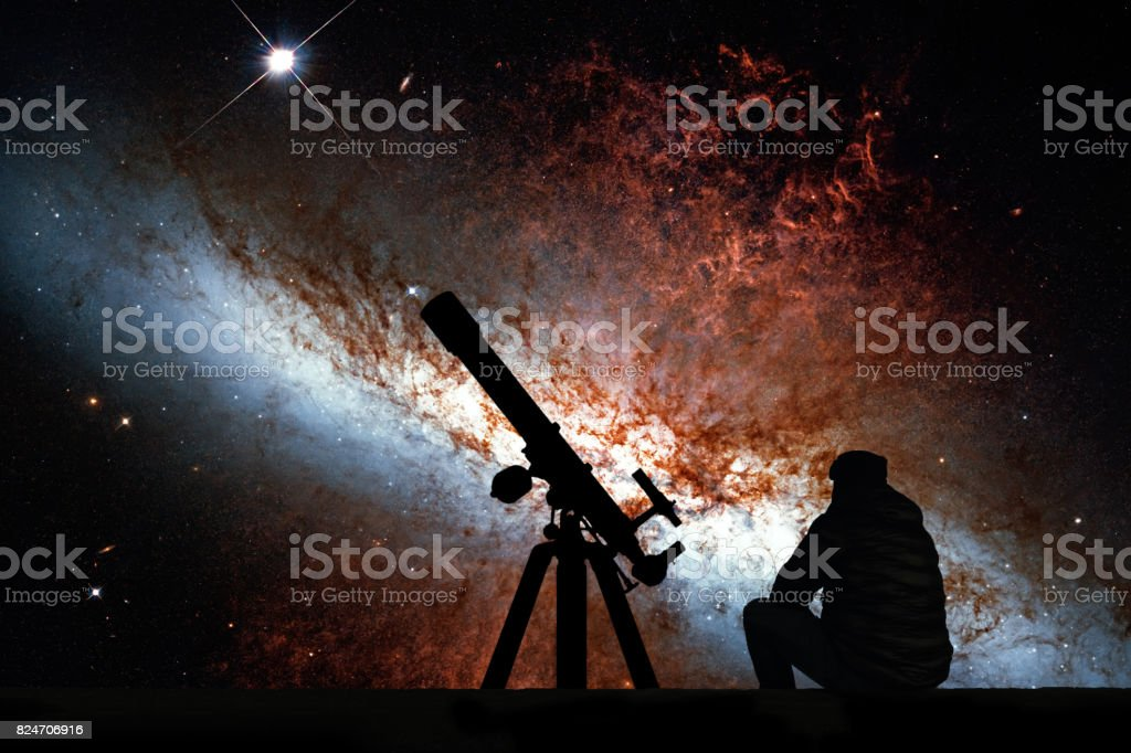 Man with telescope looking at the stars. Messier 82, Cigar Galaxy or M82 in the constellation Ursa Major stock photo
