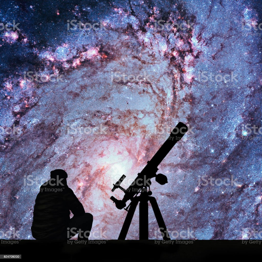 Man with telescope looking at the stars. Messier 83, Southern Pinwheel Galaxy, M83 in the constellation Hydra. stock photo
