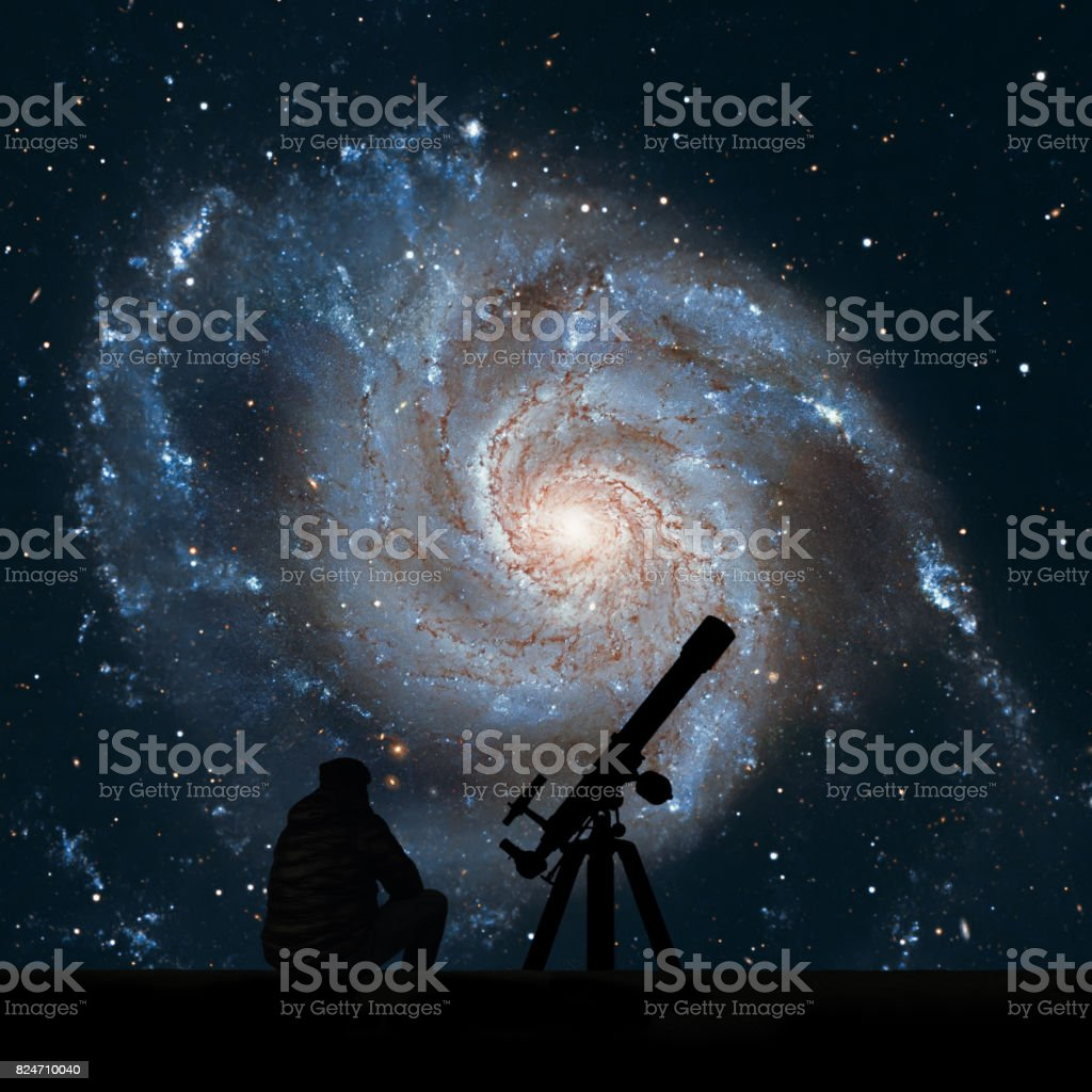 Man with telescope looking at the stars. Pinwheel Galaxy Messier 101, M101 in the constellation Ursa Major stock photo