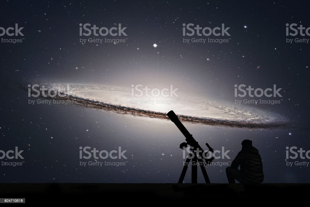 Man with telescope looking at the stars. Sombrero Galaxy M104  in constellation Virgo. stock photo