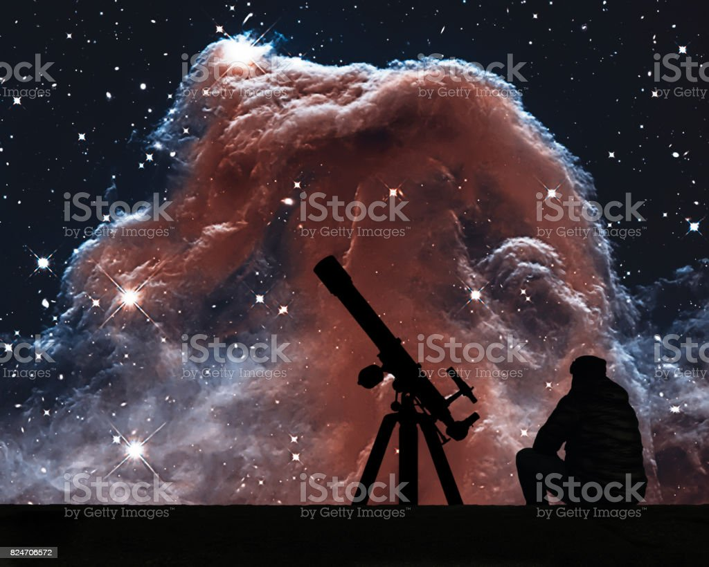 Man with telescope looking at the stars. The Horsehead Nebula in the constellation of Orion (The Hunter) stock photo