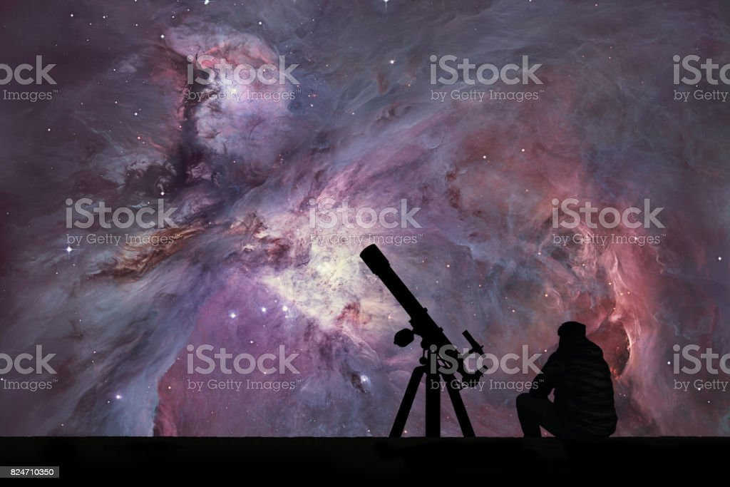 Man with telescope looking at the stars. The Orion Nebula Messier 42 diffuse nebula  in constellation Orion. stock photo