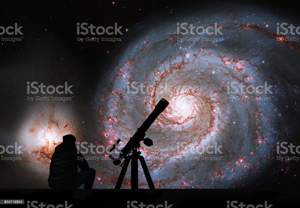 Man with telescope looking at the stars. Whirlpool Galaxy. Spiral galaxy M51 or NGC 5194 stock photo
