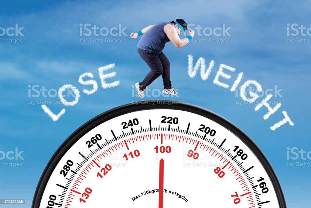 Man with text lose weight and scale stock photo