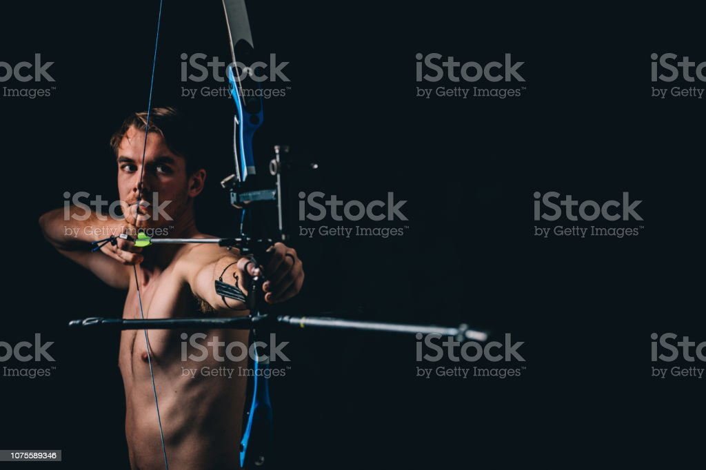 Young archer with the bow and arrow