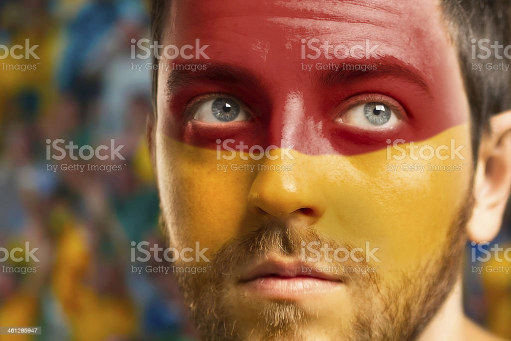 Man with the flag of Spain painted on his face stock photo