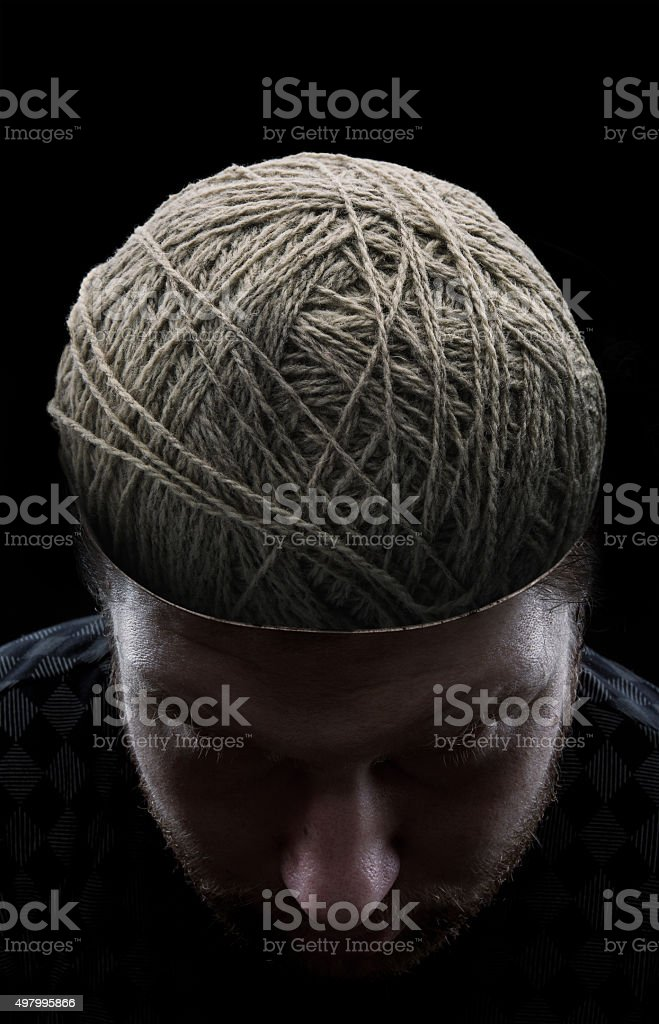 Man with threads in his head stock photo