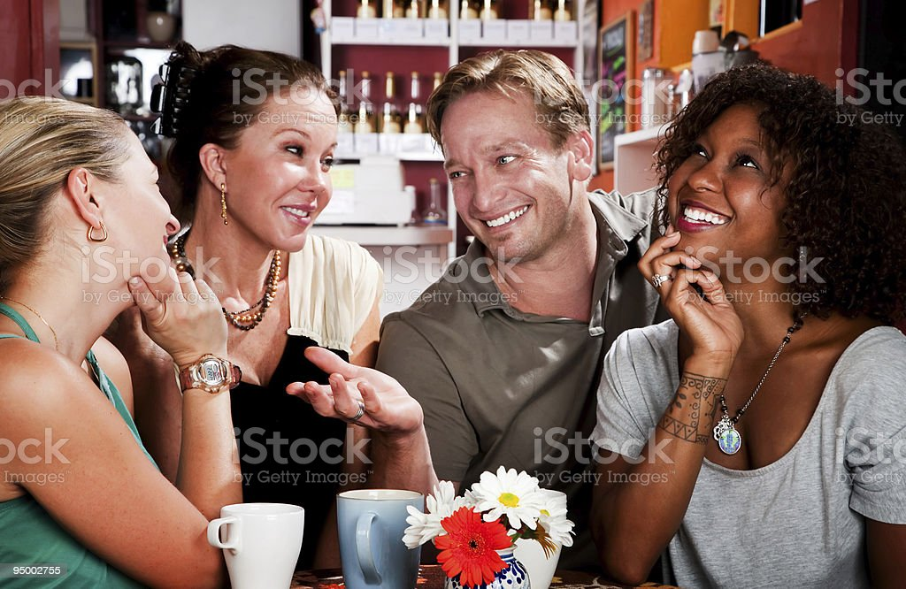 Man with three pretty women in coffee house royalty-free stock photo
