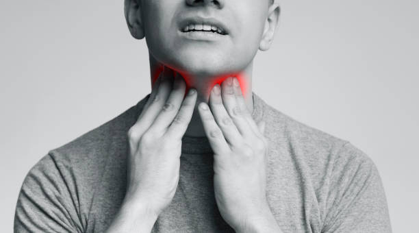 Man with thyroid gland problem, touching his neck Man with thyroid gland problem, touching his neck, close up, panorama carcinoma stock pictures, royalty-free photos & images
