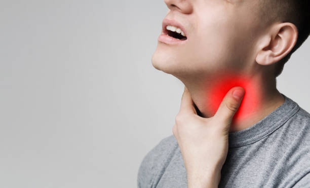 Man with thyroid gland problem, touching his neck Man with thyroid gland problem, touching his neck, closeup, panorama, empty space carcinoma stock pictures, royalty-free photos & images