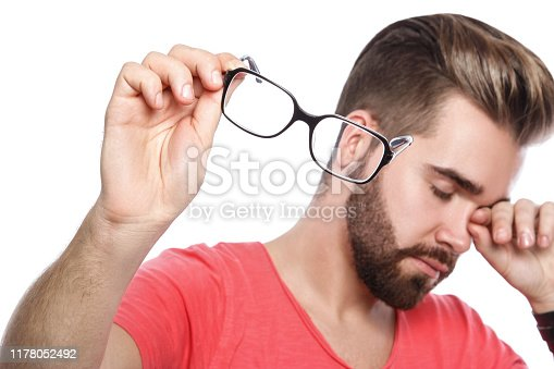 626964348istockphoto Man with tired eyes 1178052492